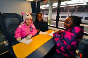 Emmah, Angel and Katie relax on the Acela.
